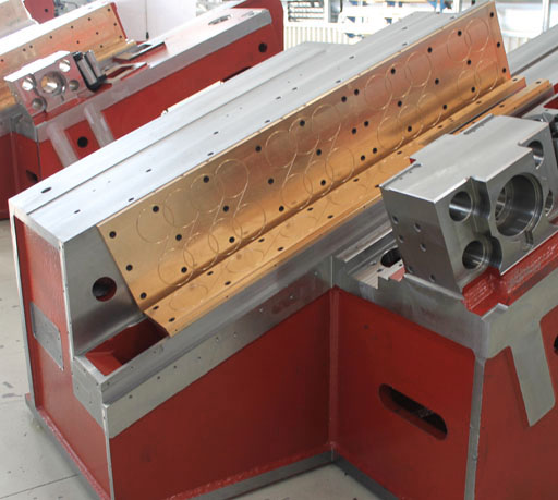 Main Frame, ingramatic, design, material, manufacturing, precision, reliability, thread rolling machine, experience, simulation systems, experimental, steel, thermal stress,vibrations, high production speeds, rigid system, new design